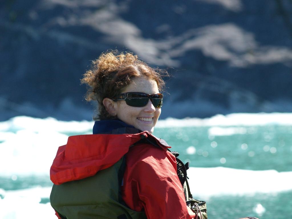 Woman kayaker smiling at LeConte Glacier Alaska