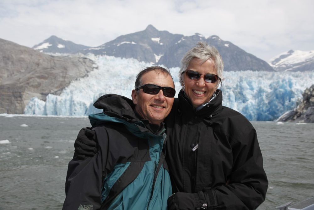 Chuck & Marcia Kerl pose in front of LeConte Glacier