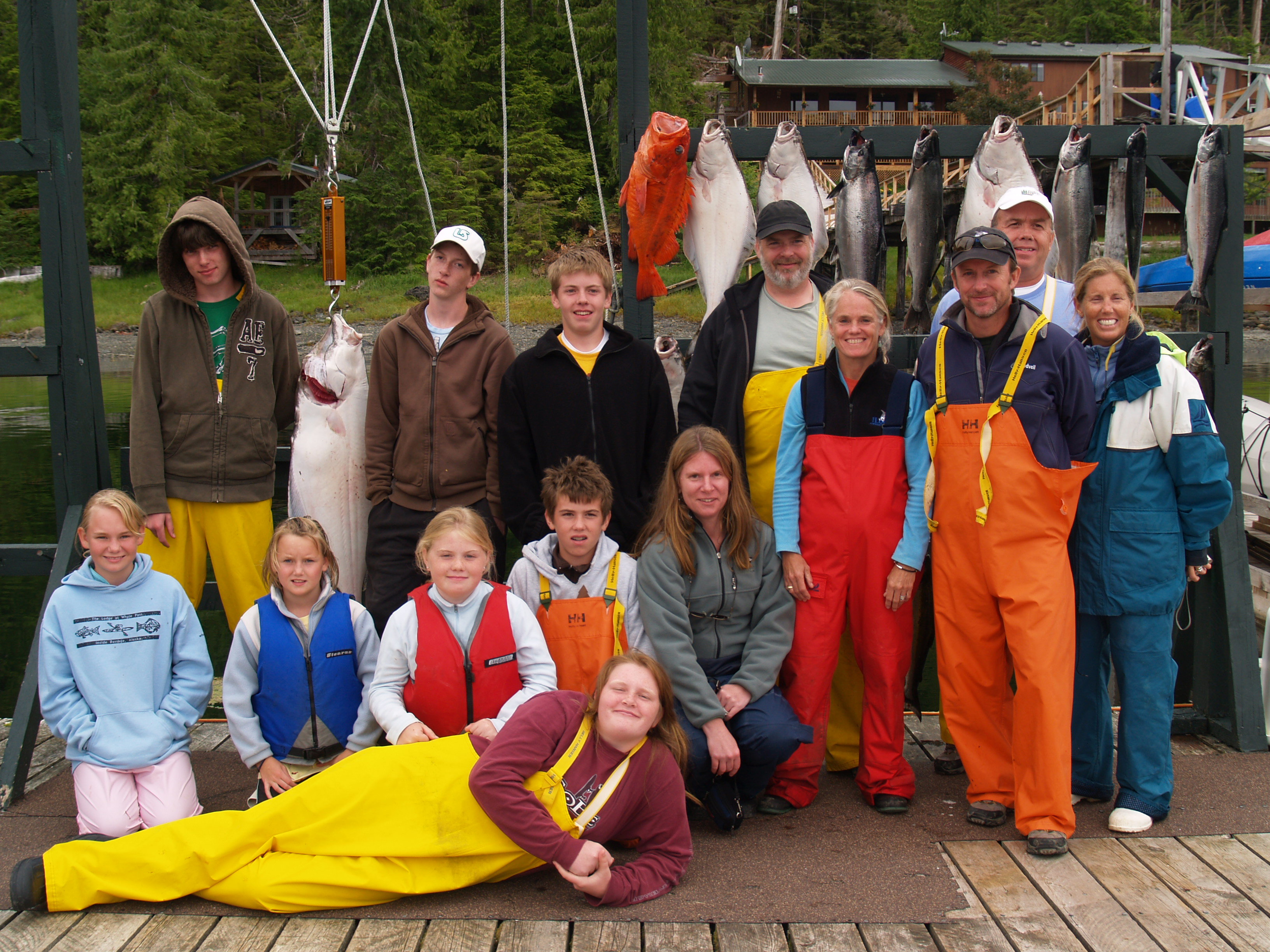 Sweeny family pose with halibut and salmon at The Lodge at Whale Pass